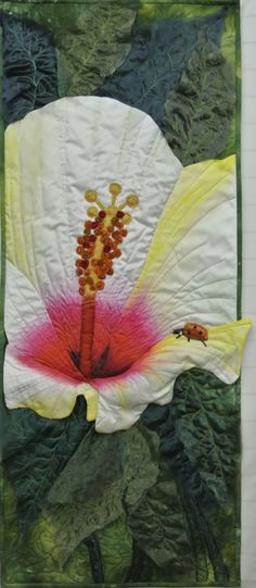Hawaiian Beauty I by Leslie Forbes | Fibre Art Network (Canada). Fabric: ice dyed. Applique, embellishment, machine quilting