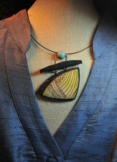 Following The Light pendant around the neck by Page's Creations, via Flickr