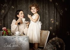 What a whimsically delightful, thoroughly lovely image of a mom and her young child enjoying a spot of afternoon tea. #vintage #mother #mom #child #children #family #lifestyle #photography #whimsical #bubbles #shoot