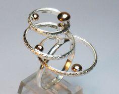 Sterling silver kinetic spinning statement by RadiantOriginals