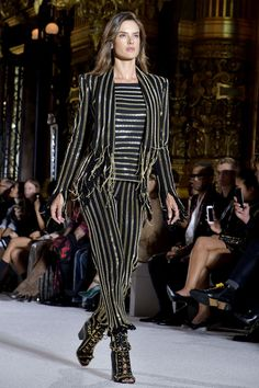 "Alessandra Ambrosio takes to the Balmain catwalk in a beaded and embroidered trouser suit. [link url=""http://www.vogue.co.uk/shows/spring-summer-2018-ready-to-wear/balmain""]See who joined her on the runway here[/link]."