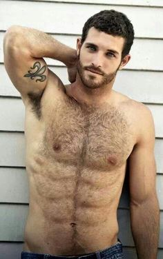 Tattooed men: his eyes are so amazing! And love the manly hair.