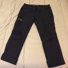 Express cargo Capri Black cargo capri pants. both cargo pockets have button openings. I have them rolled up at the bottom, since that's how I wore them. They look so great on!!! make me an offer  Express Pants Capris