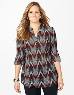 Flatter your figure with our must-have tunic featuring a captivating chevron print. Cascading pleats gracefully release at the hem for a feminine finish. Notch neckline with rhinestud accents. Bust darts. Three-quarter sleeves. Catherines tops are perfectly proportioned for the plus size woman. catherines.com