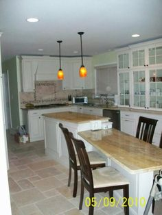 Solid wood Maple cabinets painted in chantile egg shell.