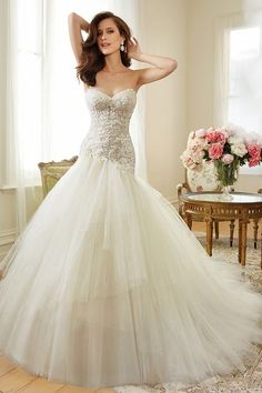 Stunning fit and flare wedding gown with a voluminous tulle skirt | Sophia Tolli…
