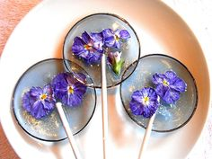 Behold the lollipop flower, a rare type of plant species that grows only in the shadows of a particular mountain in remotest Tibet. Ok, so I'm lying. But the lollipops in these pictures below are no less majestic than their make-believe counterparts.