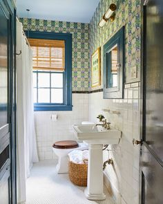 Green and blue bathroom features a white pedestal sink fixed against white hexagon floor tiles and accented with a chrome cross handle faucet fixed in front of square grid backsplash tiles. Ashley Gilbreath, Penny Tile Floors, Ikea Shoe Cabinet, Apartment Painting, Turquoise Bathroom, Grey Baths, Pedestal Sink, Bathroom Fixtures, Easy Projects