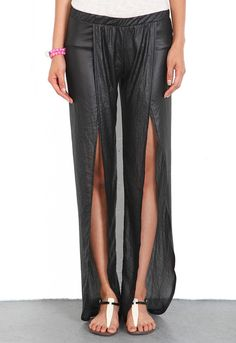 Nightcap Clothing Tulip Pant in Black  This Crepe Skirt is use a fabric to create lines and crinckle to add movement