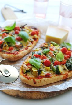 Grilled veggie naan pizzas