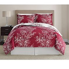 This bedding set features a beautiful red tree pattern on white comforter with the negative image on the reverse side. Matching sheets and pillowcases feature a stenciled pattern of leaves, softening the bold tones of the comforter and shams.