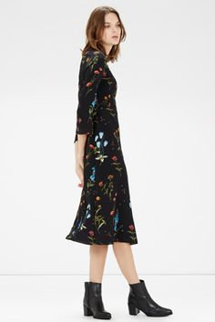 This 70s inspired midi dress is constructed from a soft woven fabric and features a round neck, 3/4 length bell sleeves and a concealed zip on the back. Height of model shown: 5ft 10 inches/178cm. Model wears: UK size 10.