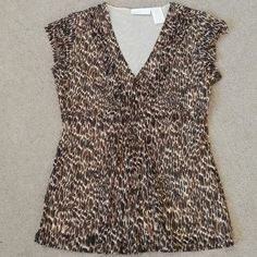 Leopard print top! Pleats and gathers up center and pleats on sides of V front. Nylon & polyester. Also has a cream lining. Black, brown & cream. Worthington Tops Blouses