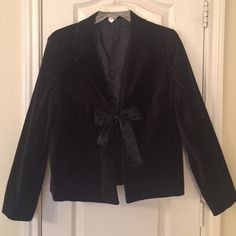 Black Velvet Jacket - Reduced on 12/20! Festive velvet blazer. Hook & eye closure with pretty satin ribbon bow detail in front. Buttons at bottom of sleeves. The Velvet is not the softest, most luxurious quality, but for Old Navy, it's nice. Worn once to a holiday party. Old Navy Jackets & Coats Blazers
