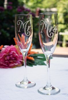 Mr and Mrs toasting flutes champange flutes by rachelwalter, $25.00   *These are my flutes. I'll probably dress them up with just a bow on the stem :) *