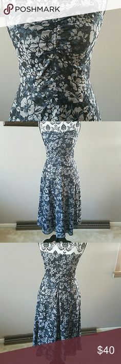 J.CREW STRAPLESS DRESS Lovely A-line silhouette with ruching in the chest and optional spaghetti halter tie strap. Has boning and grippers for extra suport in the chest. Black with blue and gray floral pattern. 60% Polyester 40% Cotton with 100% Cotton lining. In EUC. Worn once J. Crew Dresses Strapless