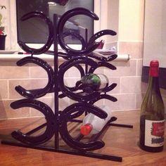 Bespoke horseshoe winerack for home inspired by others ideas on Pinterest. #horseshoe #welding #creative #winerack #bespoke