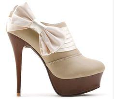 Google Image Result for http://i01.i.aliimg.com/wsphoto/v0/619943633/New-design-Kvoll-bowtile-ankle-boots-fashion-floral-high-heel-boots-sexy-grace-women-dress-pumps.jpg