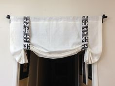 This listing is for one burlap London shade. It is completed with 2 side straps in black/white greek key design.  *** This is not a pull-up treatment which you can operate with string and mechanism. *** For your reference, this listed treatment is 44 wide on a 42 wide rod.  *** For 70 − 80 wide valance, it will have 2 center drops and 2 tails. 3 adjustable straps will be included as well. Easy installation is fabricated for this valance. Last Picture shows valance with 2 center drops an...