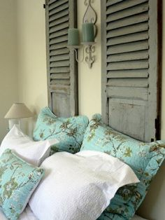 Bedroom design vintage pillow turquoise color candles old decorative shutters