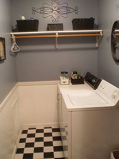 my 186 laundry room makeover, design d cor, laundry room mud room, After Soft blue gray color on the walls beadboard and trim new floor and black accessories and baskets to help with organization Much better