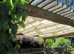 Canvas + lights for shade and ambiance outside! Great summer idea for back yards or porches.