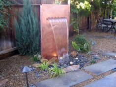 Give a landscape a Mediterranean makeover with a sophisticated copper water feature.