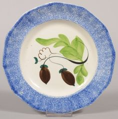 """Sold For $ 500  Blue Acorn Spatterware Plate. Twelve sided rim with blue spatter, white center showing two brown acorns with teal caps and green leaves. 8 1/4""""dia. Condition: Good, no damage."""