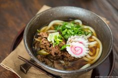 Beef udon is a Japanese comfort dish made of tender sliced beef seasoned and stir fried on top of warm udon noodle in a savory dashi broth.