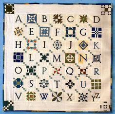 from Marie Claire Idées (June 2008). Posted by Monica Hering at http://confrariadopatchwork.blogspot.com Quaker-sampler-style alphabet with alternating blocks -- here, used the intricate little DEAR JANE ones, but good for many collections, or even square charms two-of-a-kind squares