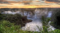 The Iguazu Falls which runs from Brazil to Argentina is known to be the most beautiful waterfall in the world. In fact it is said that the United States first lady Eleanor Roosevelt said Poor Niagara! when she first saw the Iguazu Falls. Beautiful Places In The World, Places Around The World, Around The Worlds, Places To Travel, Places To Visit, Travel Destinations, Travel Deals, Iguazu Falls, Les Cascades