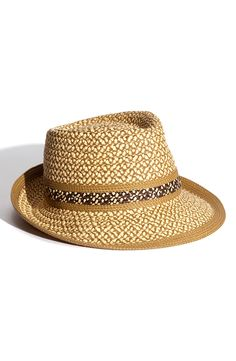 Wearing this cute fedora poolside this summer.