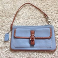 "Coach Wristlet Barely used Coach Wristlet - blue with brown trim- approximately 5"" in length. Coach Bags Mini Bags"