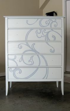 i might do something similar to this on my nightstand... maybe just a glaze so that the design is really subtle?