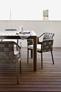 Outdoor Dining Chair- checking arm height with table.
