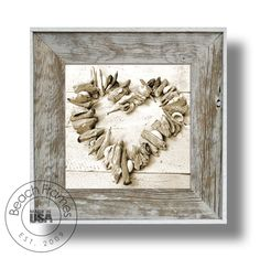 """14"""" x 14"""" driftwood heart artwork on canvas print within a white washed weathered reclaimed cypress wood 22"""" x 22""""  frame.  Not made from dingy pallet wood. Made in the USA. Visit www.BeachFrames.com"""