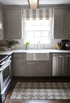 Well, except for getting rid of the light in the center of the kitchen and adding some recessed lights I think we are finally done with our kitchen makeover! The finishing touches were the beautiful p