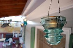 What a cute idea! Now I can put all those glass insulators we have to use!