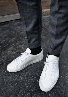 Can't go wrong with white sneakers and crisp trousers.