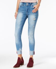Rock a lived-in vibe in these ripped skinny jeans from Indigo Rein. | Cotton/polyester/spandex | Machine washable | Imported | Mid rise; skinny fit through hips and thighs; skinny leg | Approx. inseam