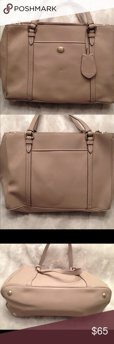 COACH Peyton LEATHER Tote COACH#B1480-F25669. Clean liner. Look at the last pic, one of the strap has a little bit undoing on the seam but it's not cracking. Small faint scuff on one corner shown in pic. Measures 9x13 Coach Bags Totes