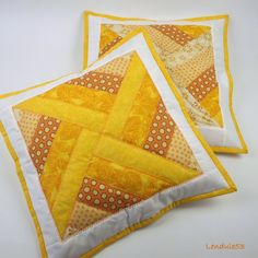 No tutorial for these lovelies but pinning for inspiration - great patchwork design and love the quilting