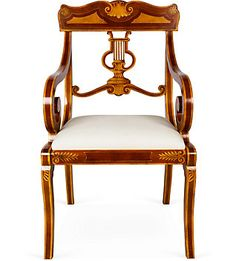 A fancy Sheraton-style armchair with a lyre-carved back splat.
