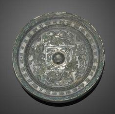 A silvery bronze inscribed mirror, Sui dynasty