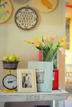 Need to get a vintage scale at the flea market. I love how she uses the gumball machine as a vase...I should do this with ours!