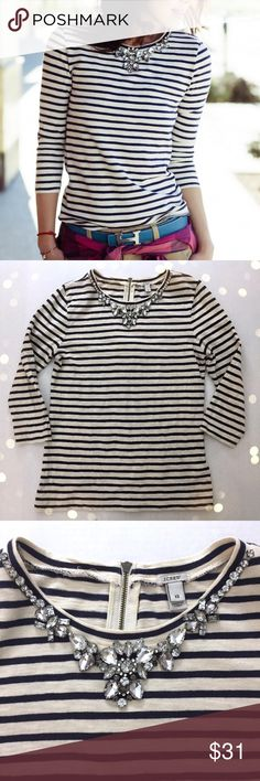 """J. Crew Stripe Necklace Tee in Blue & Ivory I'm great pre-owned condition - all stones present in collar! Some extremely minimal pilling under armpits.  •Women's size XS •100% Cotton •Cream and blue stripes with silver rhinestones at the collar •16"""" from underarm to underarm, 23"""" from shoulder to hem •3/4 length sleeves, zipper closure at back •Retail $65 •Photo credit to FitFabFunMom! ✔️Make me an offer! ✔️ 🚫no trades nor lowball offers🚫 Thank you for shopping in my closet!! J. Crew Tops…"""