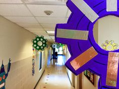 WOW! Love this use of gears in this hallway! Creates fun and interest while meeting fire codes! Workshop of Wonders: Vacation Bible School Christ UMC (KY) www.cokesburyvbs.com