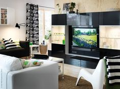 BESTÅ can help you to clean the clutter and get your living room prettied up!