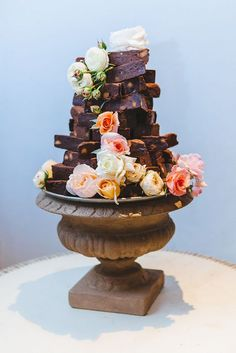 A DIY Wedding Cake - Stack brownies up with some cascading flowers and you have a cake that is sure to be a favorite with your guests! #weddingcake #brownies
