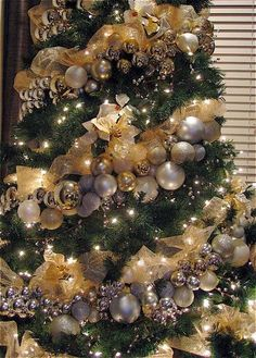 The Christmas ornaments were strung onto a long floral wire like a long garland and then wrapped around the tree.